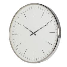elegant wall clock in copper or nickel by out there interiors