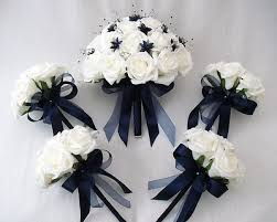 wedding flowers for bridesmaids flowers brides with 4 bridesmaids posy bouquets in ivory navy blue