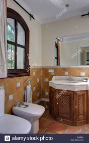 Spanish Bathroom Design by Terracotta Wall Tiles To Dado Height In Spanish Bathroom With