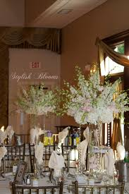 Wedding Centerpieces With Crystals by Pink Dendrobium Orchids White Larkspur And White Hydrangea