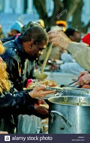 thanksgiving dinner in dc homeless people are served thanksgiving dinner by members of the