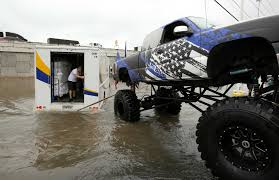 monster truck shows in texas video monster truck pulls truck from flooded houston road