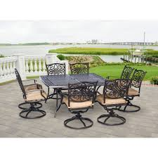 traditions 9 piece dining set with swivel chairs and 60