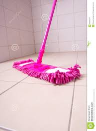pink mop cleaning tile floor in bathroom stock images image