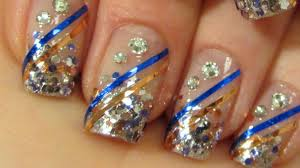 blingy bollywood princess design in copper blue and silver nail