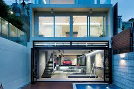 an ultra modern house in hong kong with a glass walled garage