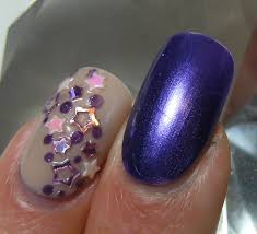 deez nailz midie metallic purple with some nail art