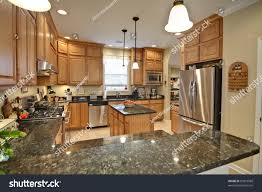 Kitchen Pictures With Maple Cabinets by Spacious Modern Kitchen Maple Cabinets Granite Stock Photo