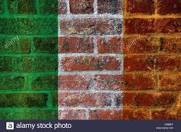 ireland flag on textured grunge brick wall background stock photo