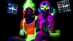 black light party clothes fantastic video of cyber raver man and woman filmed in