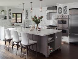 l shaped kitchen with island gray footed center island with white leather counter stools