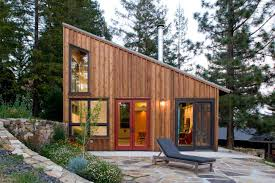 Slanted Roof House Vertical Wood Siding Slanted Roof And Large Windows