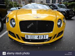 bentley custom a yellow custom bentley with dubai number plates outside the park