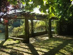 Building A Arbor Trellis How To Build A Grape Arbor Arch Trellis With A Pergola Design Hunker