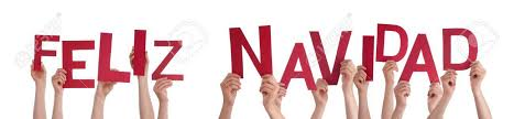 many holding the words feliz navidad which means