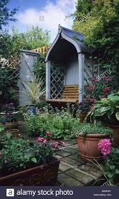 private town garden london design pamela woods covered seat in