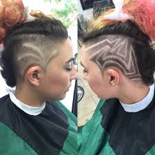 side to side mohawk undercut with designs on both sides hair