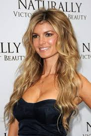 slightly longer in front hair cuts sexy center parted hairstyle long blonde waves with balayage
