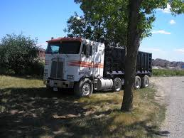kw cabover gmc conventional and kenworth cabover both dump trucks