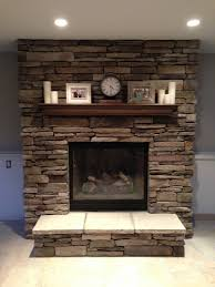clean white custom milled fireplace surround with shiplap and