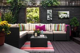 exterior design wood flooring and black garden wall in