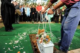 baby caskets the tiny casket of baby nicholas lowered into its grave during his