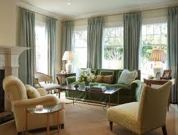 living room beige arm sofa modern side table drapes fabric glass