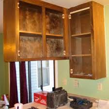 how to hang a cabinet to the wall the screws you need to hang kitchen cabinets