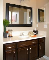 Affordable Bathroom Remodeling Ideas by Gray Wall Paint Black Mirror Frame White Granite Countertop