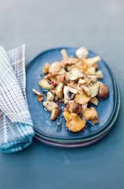 cuisiner topinambour recette de topinambours poêlés aux chignons la recette facile