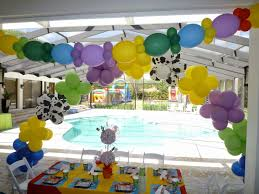cheerful backyard party decorations mixed with small white wooden