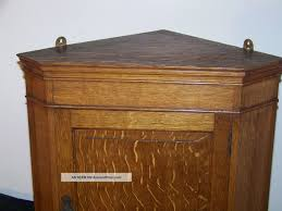 pr of cherry colonial style corner cabinets six pane bubble glass