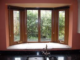 living room window treatments ideas for bay windows in modern room