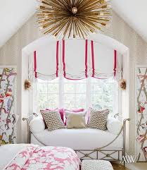 classy girls bedroom fatures arched window seat nook filled with