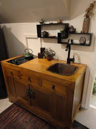 kitchen simple yellow wooden island with double sink with black