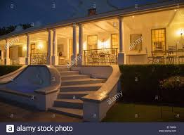 luxury house with porch illuminated at night stock photo royalty