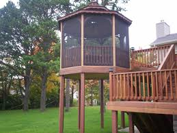 multilevel backyard deck design with round screened part for
