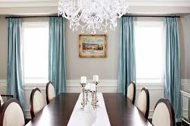 dining room curtain ideas grande chandelier with blue curtain and white chairs for