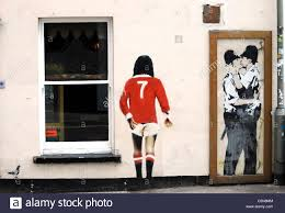 banksy graffiti stock photos banksy graffiti stock images alamy banksy graffiti on the wall of the prince albert pub in brighton the kissing policemen