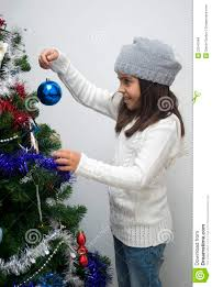 putting ornament on tree stock images image 22541964