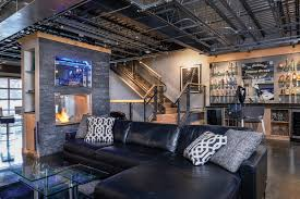 rev it up this south side pittsburgh loft is unique and unusual everything in the home is sleek from the stained and polished flooring by concrete zen to the silver and glass bar area and the garage style door that