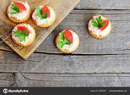 apéritif canapé canape cooked from salty crackers with spicy cheese tomato