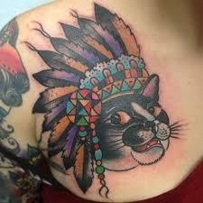 indian headdress tattoo on ribs cat in an indian headdress tattoo by greg christian tattoos book