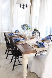 white farmhouse table black chairs blue and white kitchen table starfish coastal and black