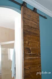 master bedroom barn doors on an authentic barn door track poofy