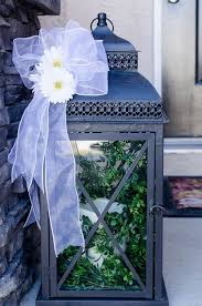 decorate an outdoor lantern for spring with these easy decor ideas