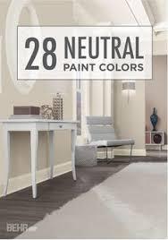behr hazelnut cream paint white trim and a light fixture that a