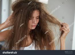 hair style in long hair damaged hair beautiful sad young woman stock photo 534972658