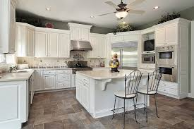 floor and decor cabinets tropical brown granite white cabinets tile floor decor