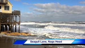 big waves on the outer banks seagull lane houses about to fall